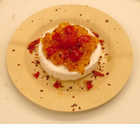 Brie topped with Peach Chutney, spicy Peppadews and Chili Flakes