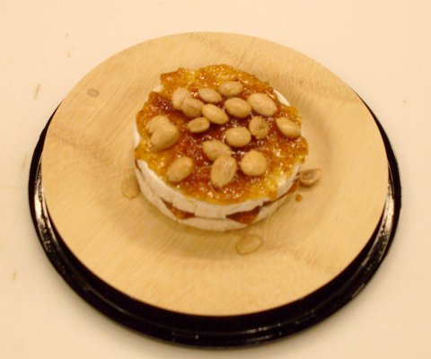 Brie topped with Fig-Orange Spread and Marcona Almonds